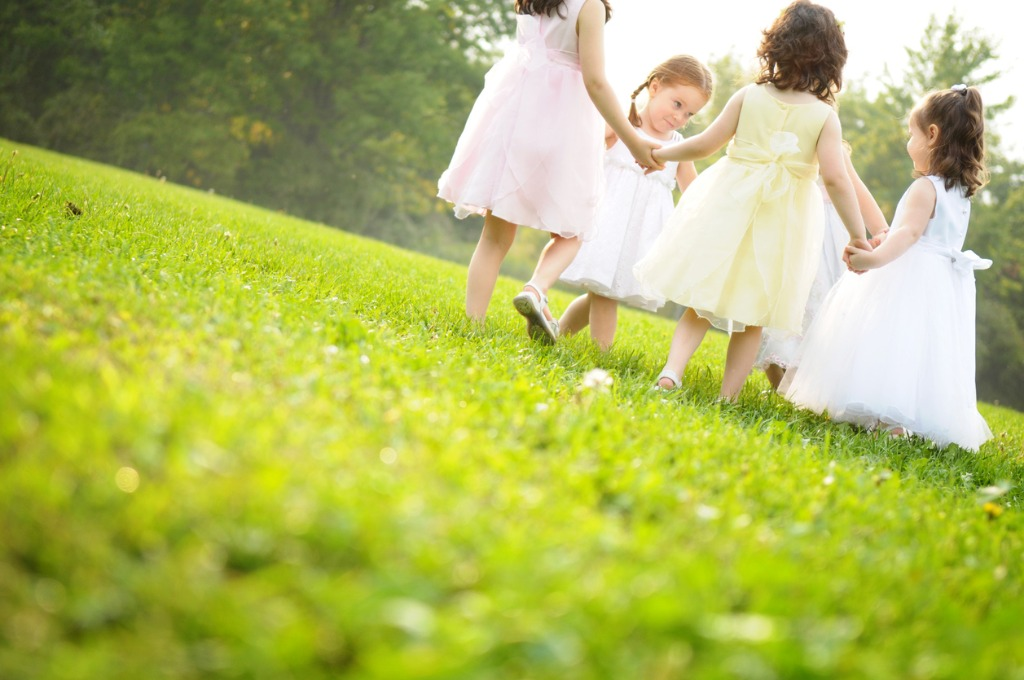 little-girls-wearing-dresses-and-spinning-in-a-circle-picture-id173025792
