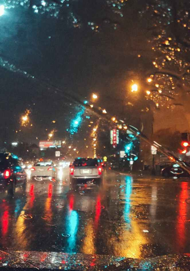 cars driving on asphalt road during rainy night