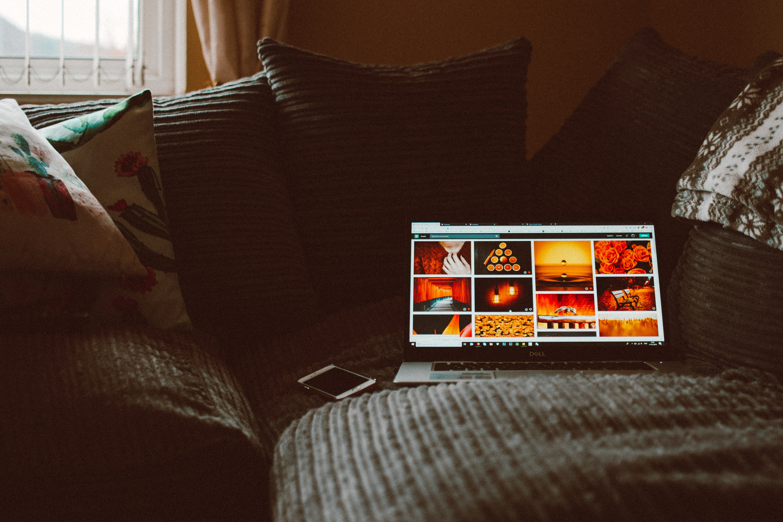turned-on-macbook-pro-on-sofa-1785871